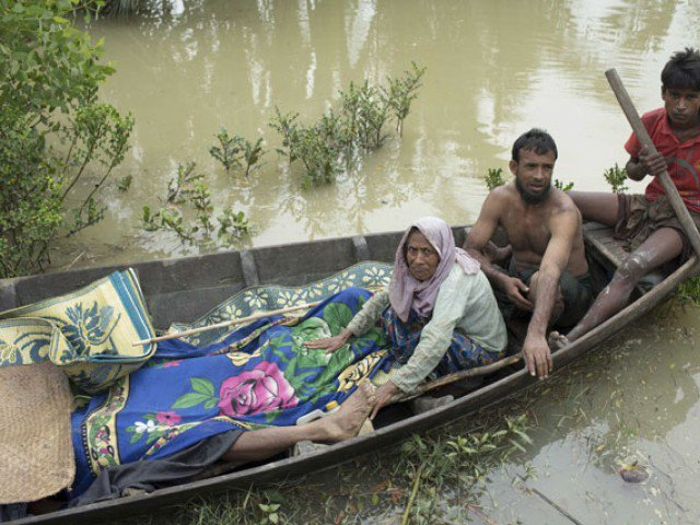 this file photo taken on september 6 2017 shows the bodies of rohingya refugees being brought to the shore of the naf river on a boat by fellow rohingyas in ukhiya photo afp
