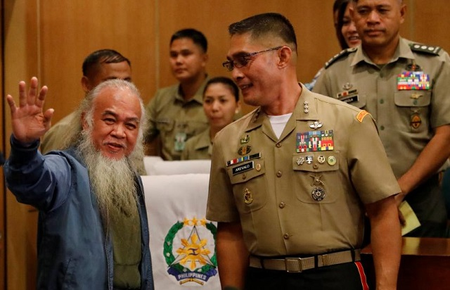 strong philippine priest smiles after is hostage ordeal ends