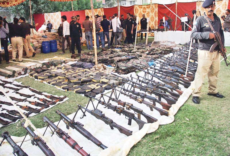 A huge cache of arms and ammunition was recovered from a customised water tank of a house in Azizabad. Law enforcers termed it 'Sindh's biggest bust' of arms in history. PHOTO: FILE