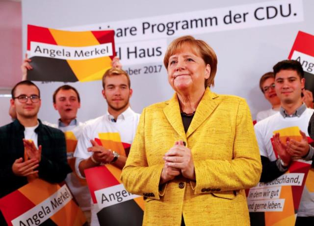 German Chancellor Angela Merkel attends a breakfast with supporters at the Christian Democratic Union (CDU) party election campaign meeting centre in Berlin. PHOTO: REUTERS