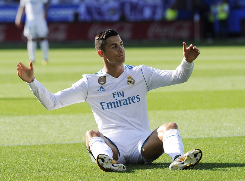 Mixed form: Ronaldo is yet to get off the mark in La Liga but did score twice in the first Champions League group game. PHOTO: AFP