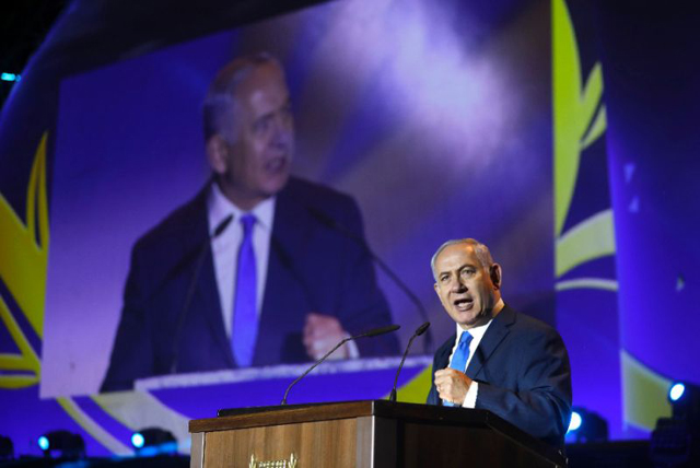 Israeli Prime Minister Benjamin Netanyahu gives a speach during a celebration of the 50 years of Jewish settlement in the occupied West Bank and Golan Heights, at a commemoration event in the Gush Etzion settlement bloc on September 27, 2017. PHOTO: AFP