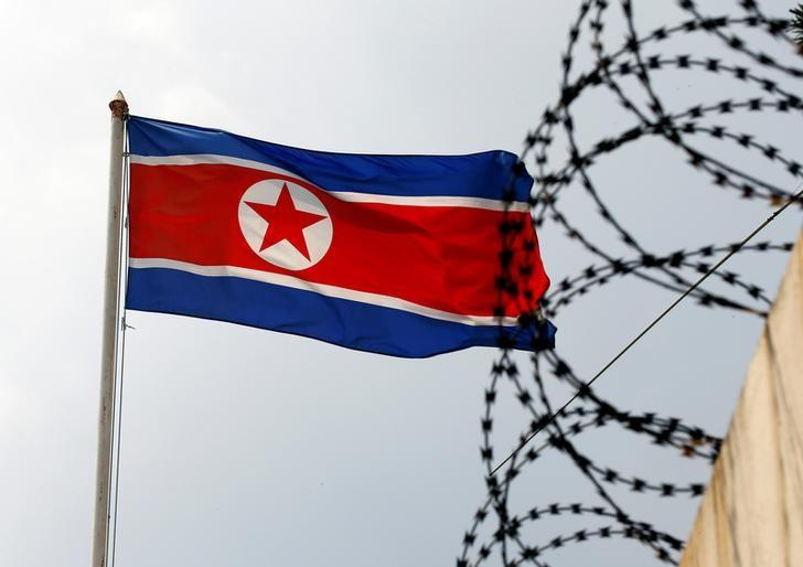 a north korean flag flutters next to concertina wire at the north korean embassy in kuala lumpur malaysia photo reuters