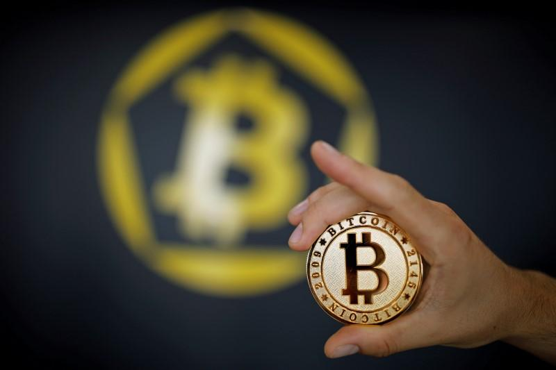 a bitcoin virtual currency coin is seen in an illustration picture taken at la maison du bitcoin in paris france june 23 2017 photo reuters
