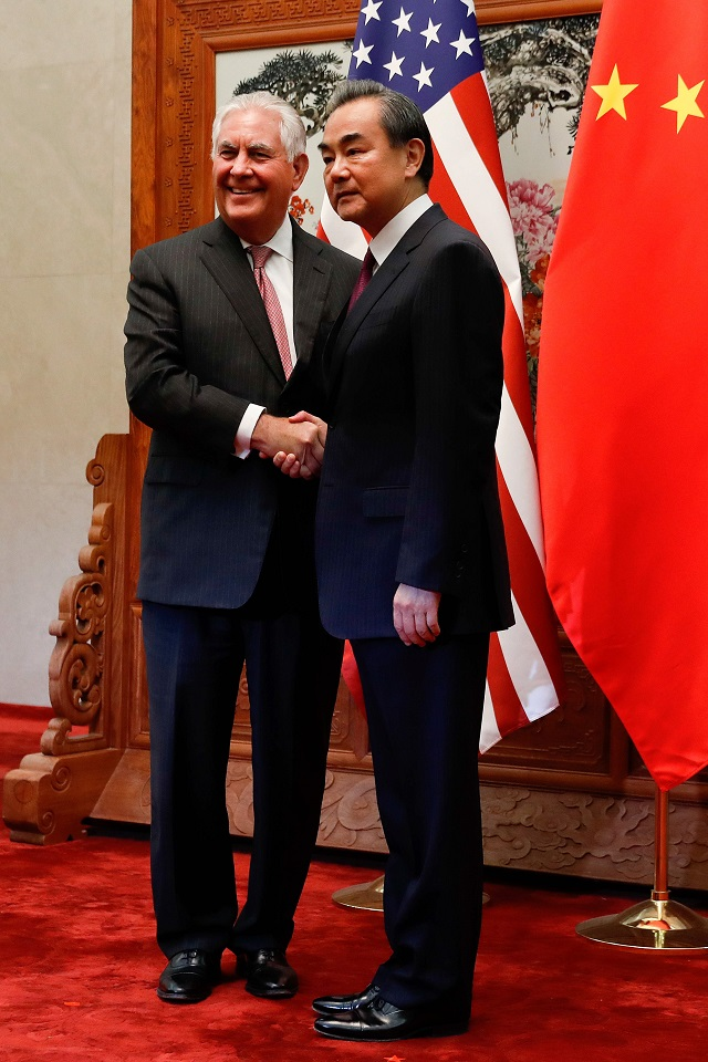 US Secretary of State Rex Tillerson (L) shakes hands with Chinese Foreign Minister Wang Yi before a meeting at the Great Hall of the People in Beijing on September 30, 2017. Tillerson met with China's foreign minister in Beijing on September 30 to discuss efforts to curb North Korea's nuclear ambitions and prepare President Donald Trump's November visit. PHOTO: AFP