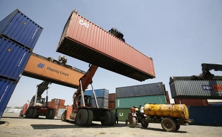mobile cranes prepare to stack containers port photo reuters