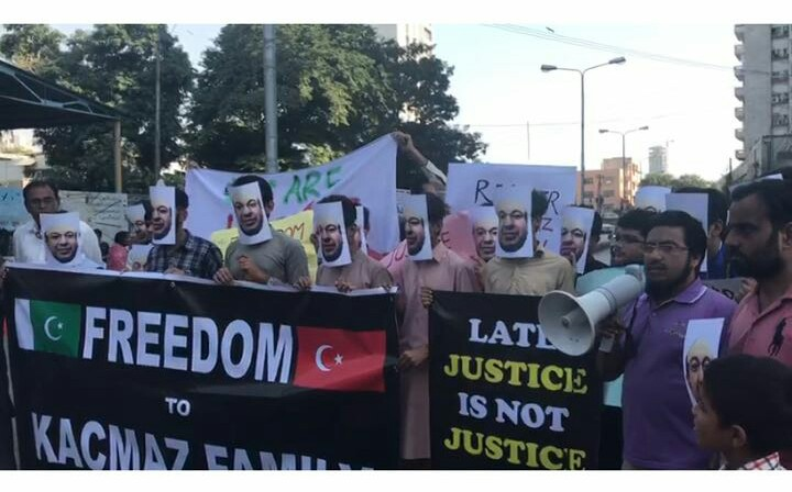 Teachers of Pak-Turk School protest the illegal detention of Mesut Kacmaz and his family. PHOTO: PPI