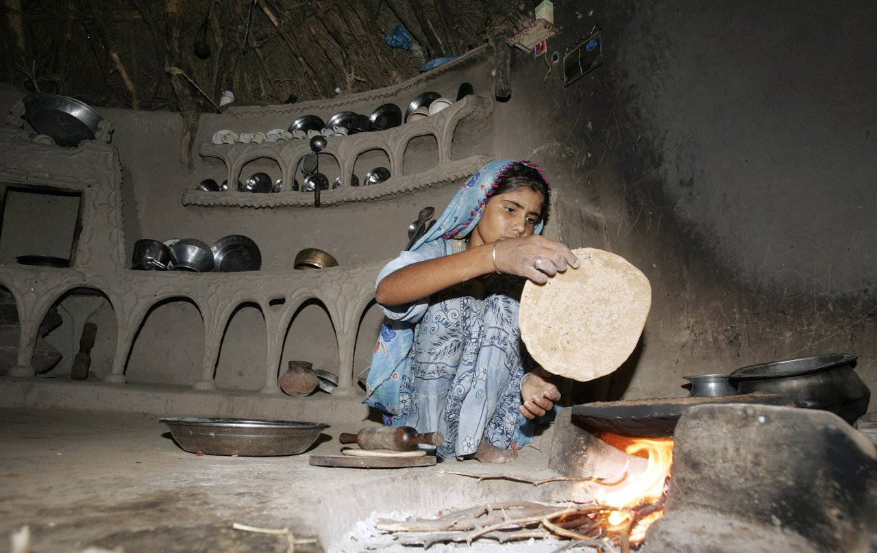 A villager prepares roti (bread) in her mud house in the village Bhattian Jivery at Tharparkar June 25, 2008. PHOTO: REUTERS/FILE