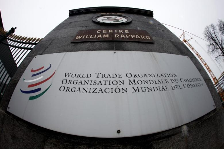 the world trade organization wto logo is seen at the entrance of the wto headquarters in geneva photo reuters