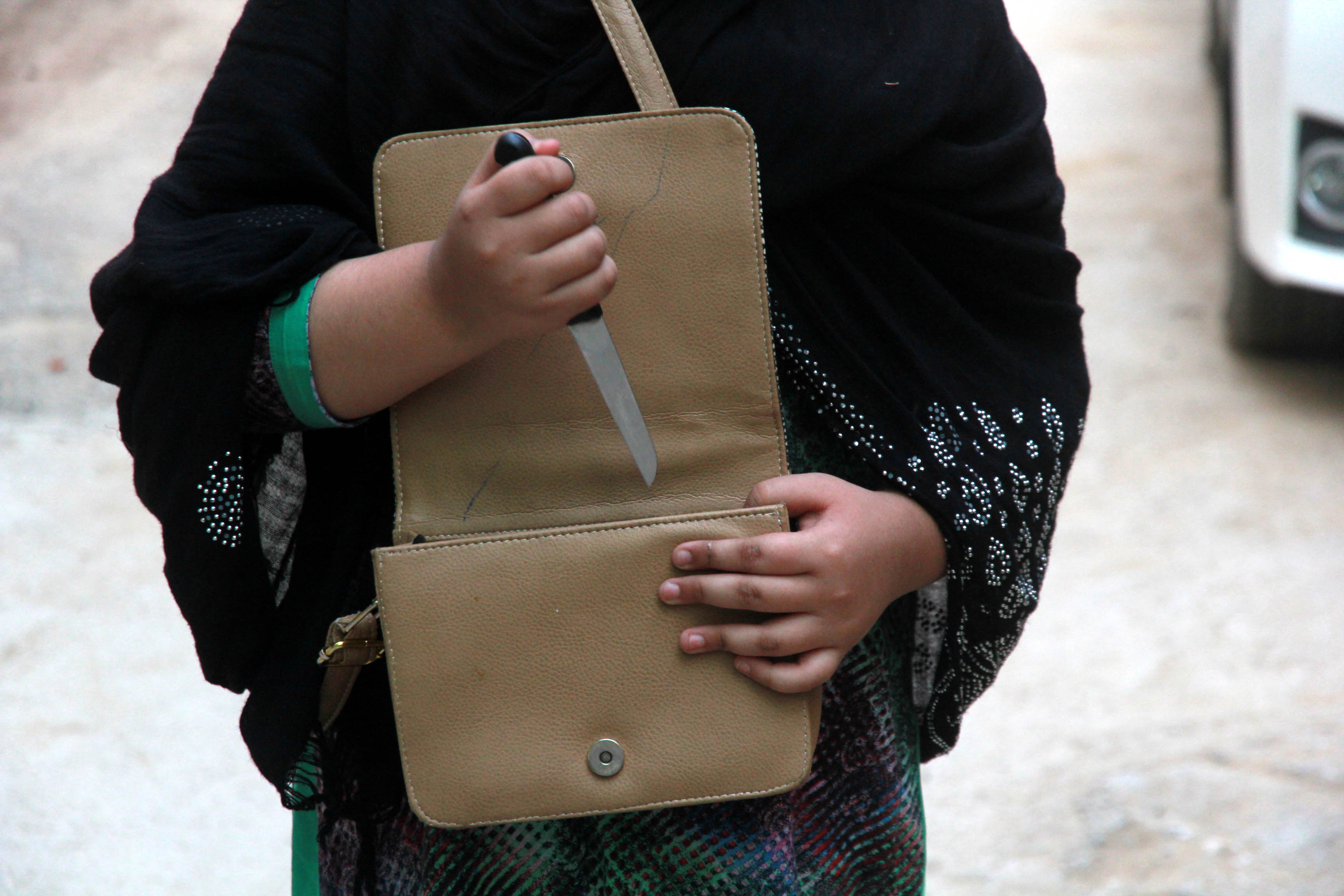 women are carrying knives in their bags to protect themselves against the knifeman photo express