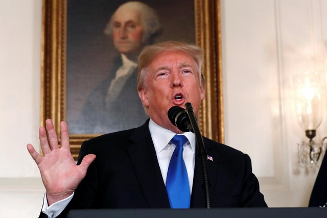 us president donald trump speaks about iran and the iran nuclear deal in front of a portrait of president george washington in the diplomatic room of the white house in washington photo reuters