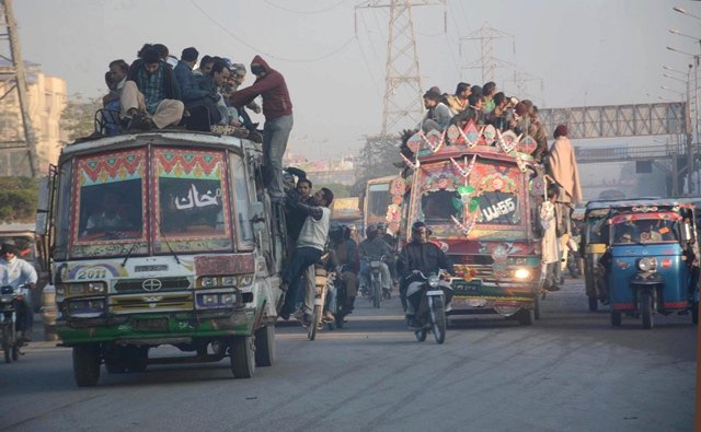 Due to the chronic lack of public transport passengers are often forced to climb atop buses. PHOTO: FILE