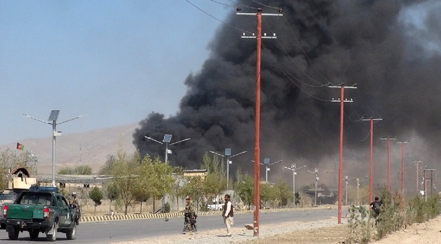 smoke billowed from a police station in gardez the capital of paktia province afghanistan on tuesday after it was attacked photo reuters