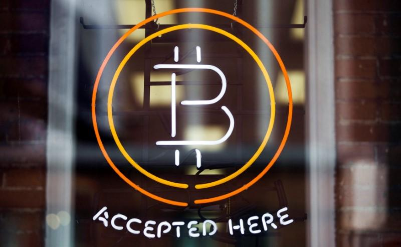 bitcoin soars to record high above 6 000