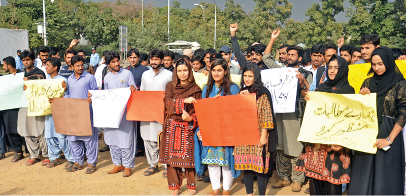 Baloch students of QAU protest in front of NPC. Photo: Online