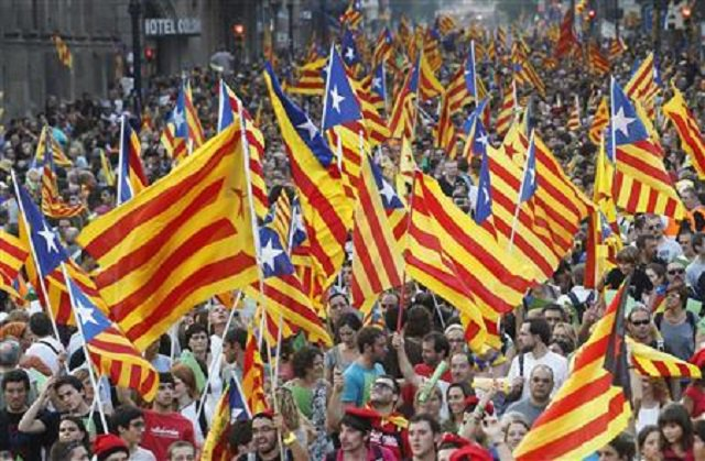 asserting rule spain seizes control of independent catalonia