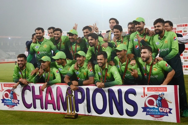The victorious Pakistan team posing with the cup