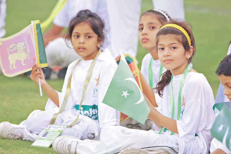children wave flags of pakistan and sri lanka during the final t20 match photo malik shafiq express