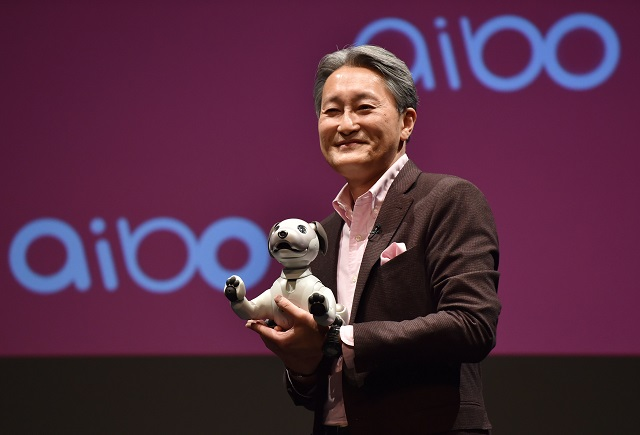 """Sony's President and Chief Executive Officer shows entertainment robot """"aibo"""" at a conference in Tokyo. PHOTO: AFP"""