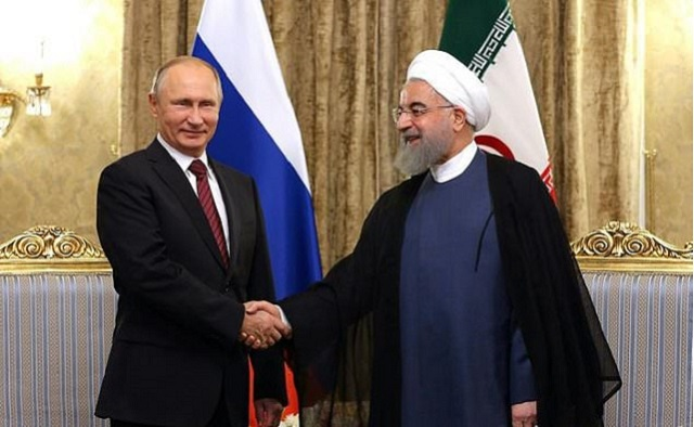 A handout picture provided by the office of the Iranian President Hassan Rouhani on November 1, 2017 shows him meeting with Russian President Vladimir Putin in Tehran. PHOTO: AFP