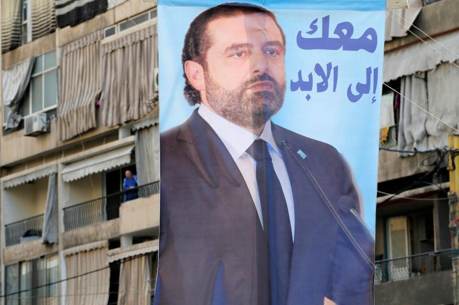"A poster depicting Lebanon's Prime Minister Saad al-Hariri, who has resigned from his post, hangs along a street in the mainly Sunni Beirut neighbourhood of Tariq al-Jadideh in Beirut, Lebanon November 6, 2017. The Arabic on the poster reads, ""With you forever"". PHOTO: REUTERS"
