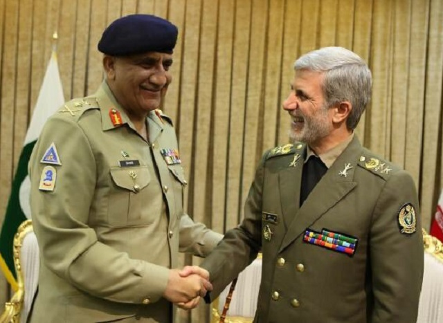 Army Chief General Qamar Javed Bajwa shaking hands with Iranian Defence Minister Brigadier General Amir Hatami in Tehran on Tuesday. PHOTO:ISPR