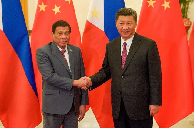 philippines scraps sandbar plan after china anger defence chief
