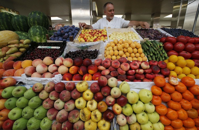 A vendor sells vegetables and fruits at the city market. PHOTO: REUTERS