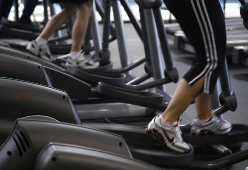 People work out on machines at a gym. PHOTO: REUTERS