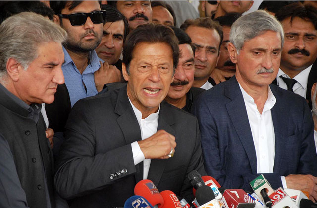 Pakistan Tehreek-e-Insaf's general secretary Jahangir Khan Tareen (R) stands as party chief Imran Khan addresses media outside Supreme Court building after a hearing into Panama scandal case on Thursday, November 3, 2016. PHOTO: ONLINE