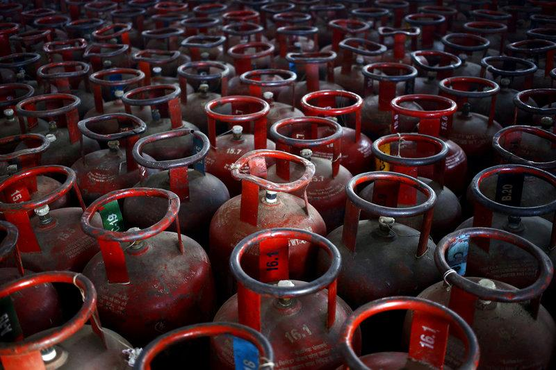 File Photo: Empty Liquefied Petroleum Gas (LPG) cylinders are seen at a gas distribution centre.  PHOTO: REUTERS