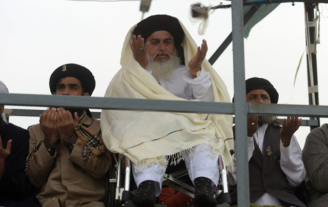 head of the tehreek i labaik yah rasool allah pakistan tlyrap khadim hussain rizvi c offers friday prayers on a blocked flyover bridge during a protest in islamabad on november 24 2017 photo afp