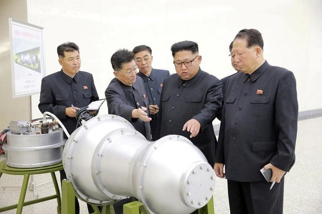 FILE PHOTO: North Korean leader Kim Jong Un provides guidance with Ri Hong Sop (2nd L) and Hong Sung Mu (R) on a nuclear weapons program in this undated photo released by North Korea's Korean Central News Agency (KCNA) in Pyongyang on September 3, 2017.    Photo via REUTERS