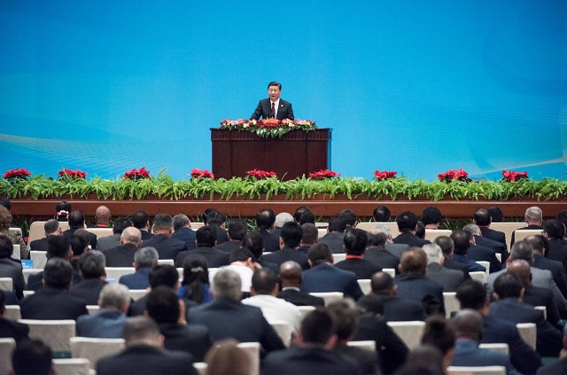"""China's President Xi Jinping speaks at the opening ceremony of the """"CPC in dialogue with world political parties"""" high-level meeting, at the Great Hall of the People in Beijing, China December 1, 2017.  PHOTO: REUTERS"""