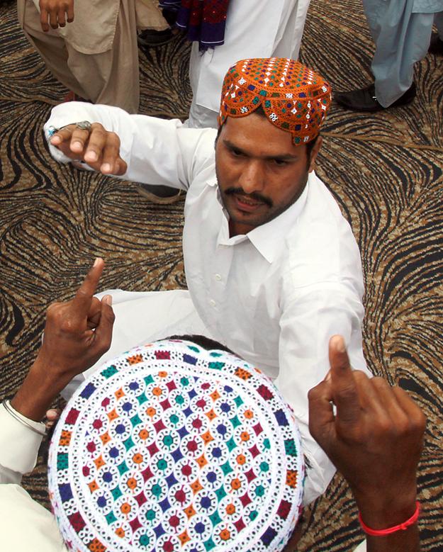 residents don ajrak and topis to celebrate sindh culture day