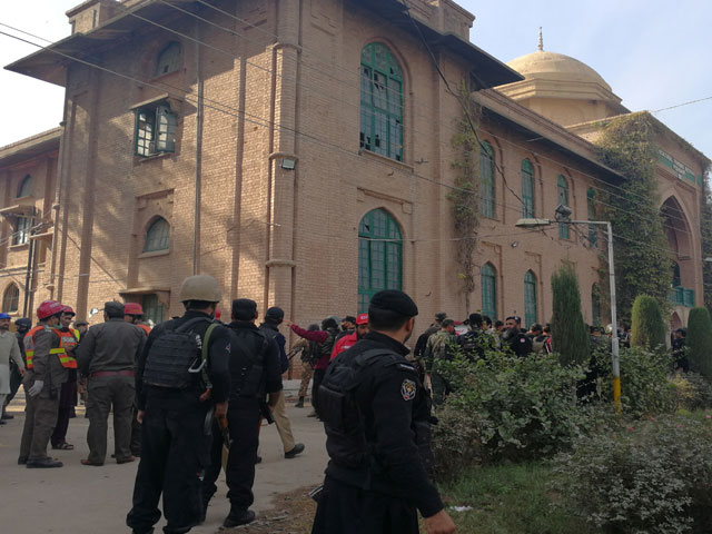 police-and-rescue-workers-stand-outside-the-directorate-of-agriculture-institute-in-peshawar-on-december-1-2017-photo-reuters