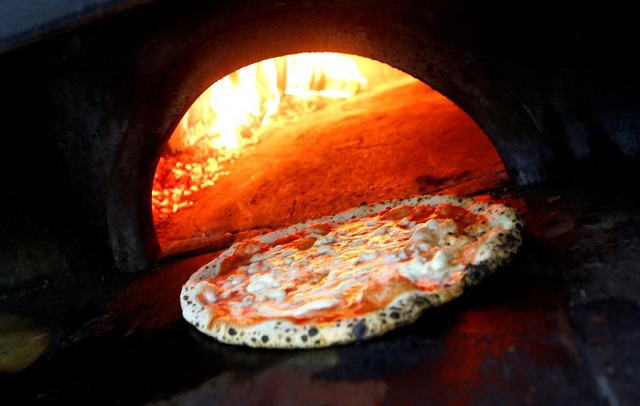 pizza margherita is prepared in a wood fired oven at l 039 antica pizzeria da michele in naples italy december 6 2017 photo reuters