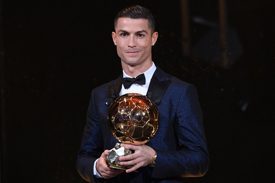 Cristiano Ronaldo poses with the 2017 Ballon d'Or France Football trophy in Paris. PHOTO: AFP