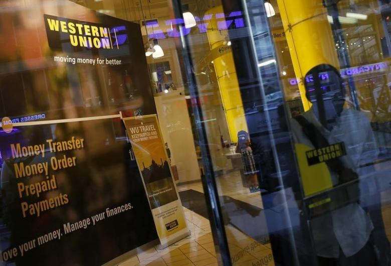 a person walks out of a western union branch in new york photo reuters