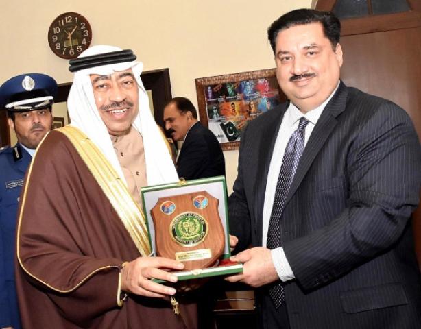Defence Minister Khurram Dastgir presents a shield to Saudi Deputy Defence Minister Muhammad bin Abdullah. PHOTO: NNI