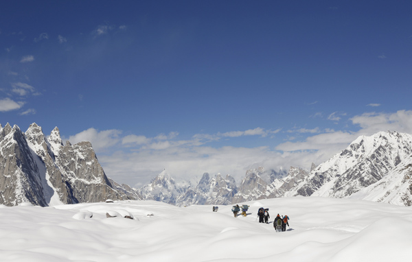 trekkers and porters hike down the baltoro glacier in the karakoram mountain range in pakistan photo reuters