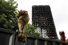 six months on london holds memorial for grenfell fire victims