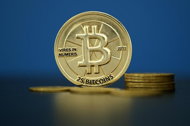 Bitcoin (virtual currency) coins are seen in an illustration picture taken at La Maison du Bitcoin in Paris, France, May 27, 2015.  PHOTO: REUTERS
