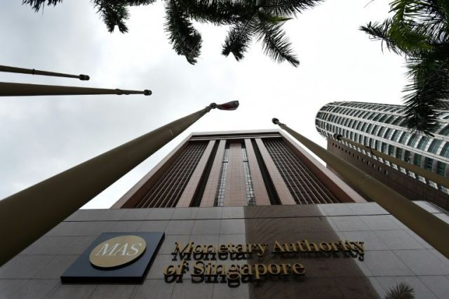 singapore hands life ban to banker in 1mdb linked cases