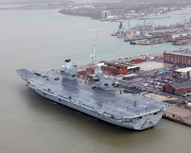 the royal navy 039 s aircraft carrier hms queen elizabeth is docked the day it was commissioned by britain 039 s queen elizabeth in portsmouth december 7 2017 photo via reuters