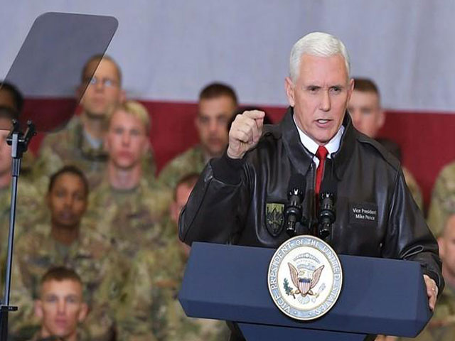 US Vice President Mike Pence arrives on stage to address troops in a hangar at Bagram Air Field in Afghanistan on December 21, 2017. PHOTO: REUTERS