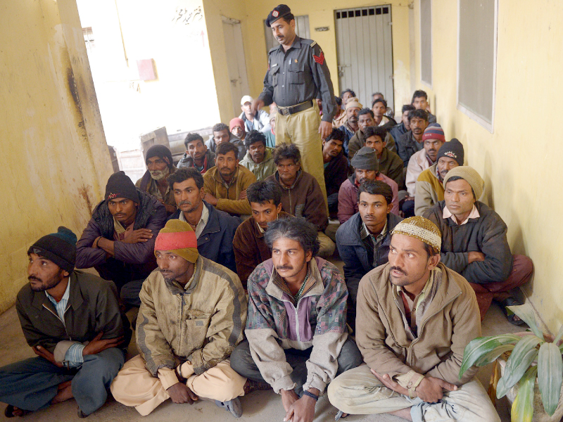 File photo of Indian fishermen waiting to be processed at the Docks police station in Karachi. PHOTO: AFP