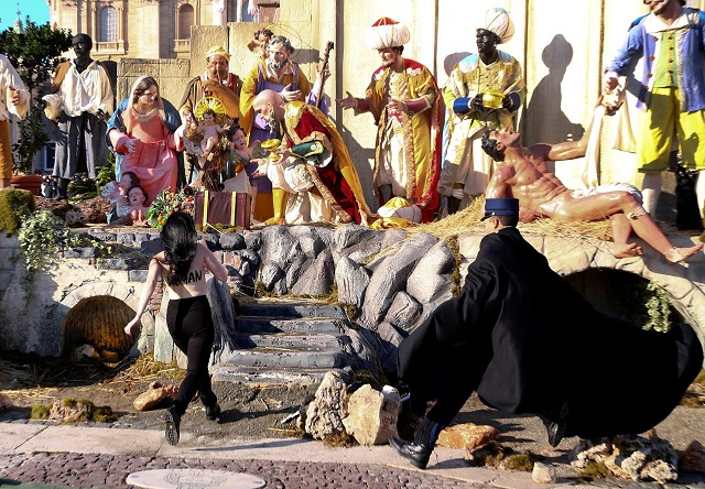 topless femen activist tries to snatch jesus statue from vatican crib