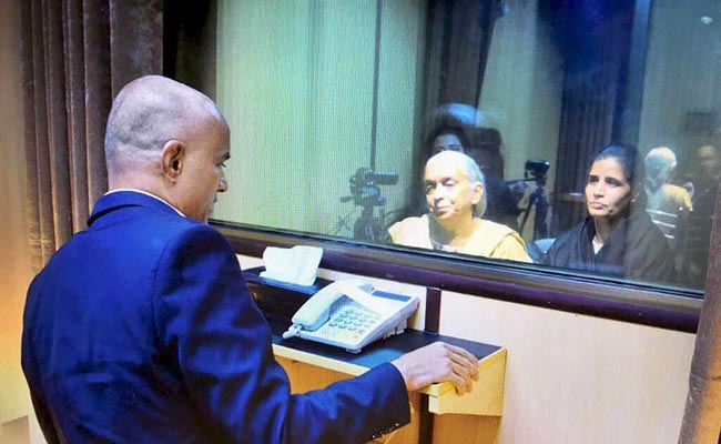 Kulbhushan Jadhav meets his family at the Foreign Office in Islamabad on Monday. PHOTO: FOREIGN OFFICE