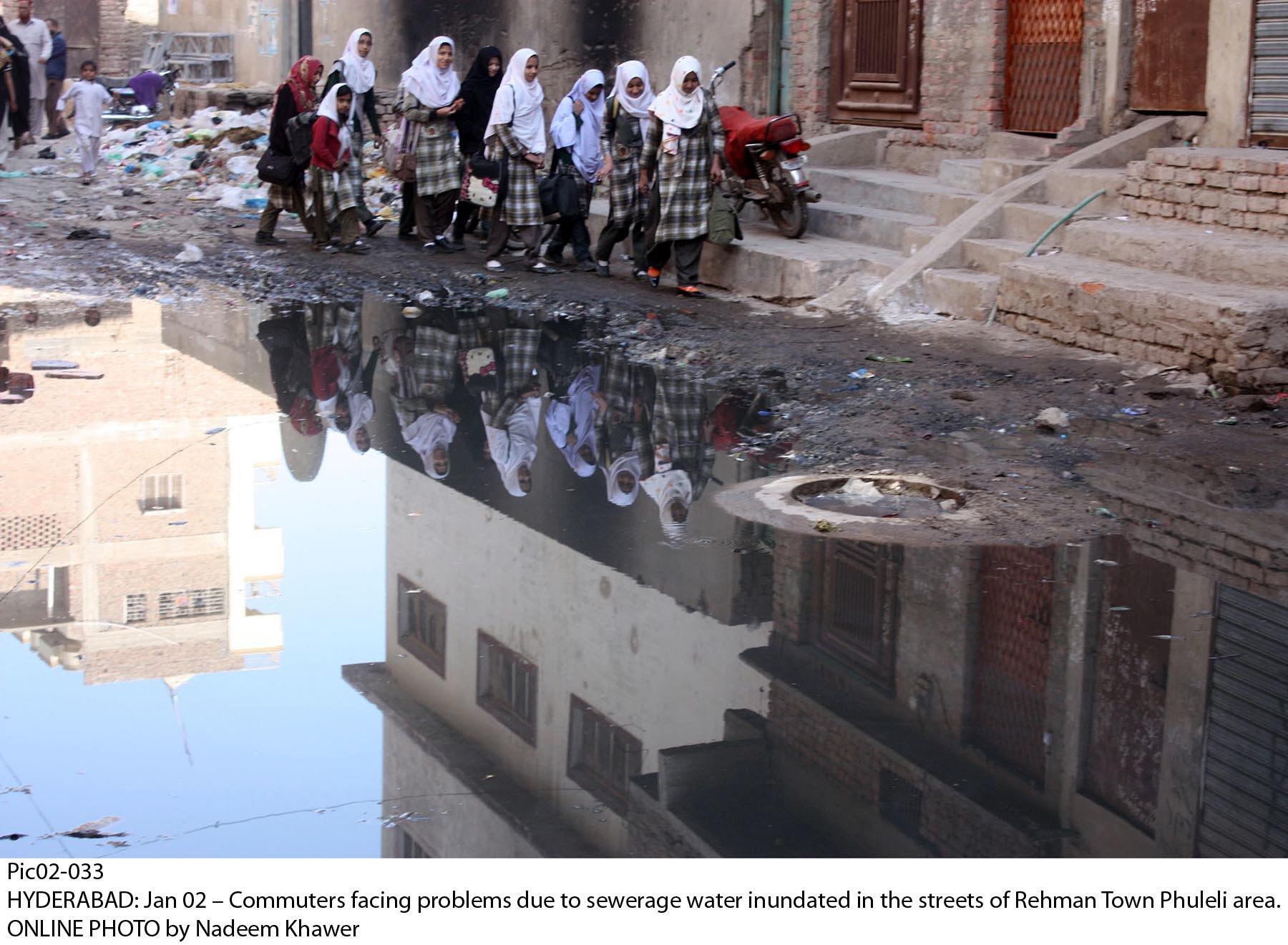schoolgirls cross a sewage filled street in hyderabad 039 s rehman town photo online